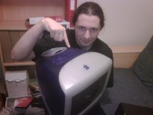 Terence holding a very old iMac