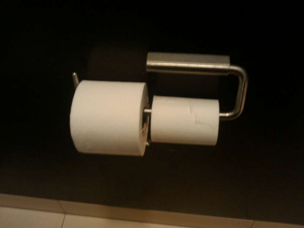Two rolls of toiet paper next to each other