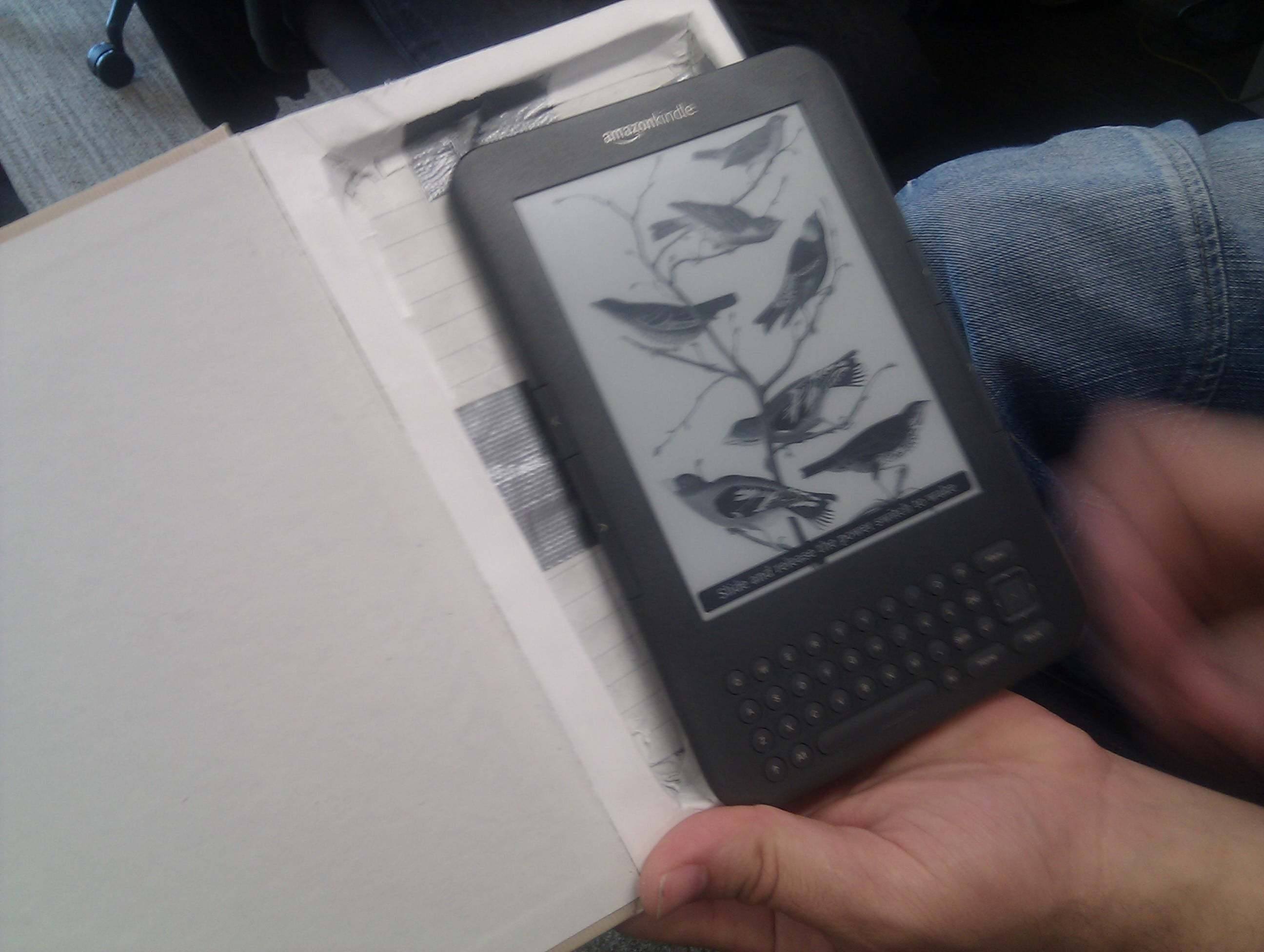A Kindle hidden in a hollowed out paper book.