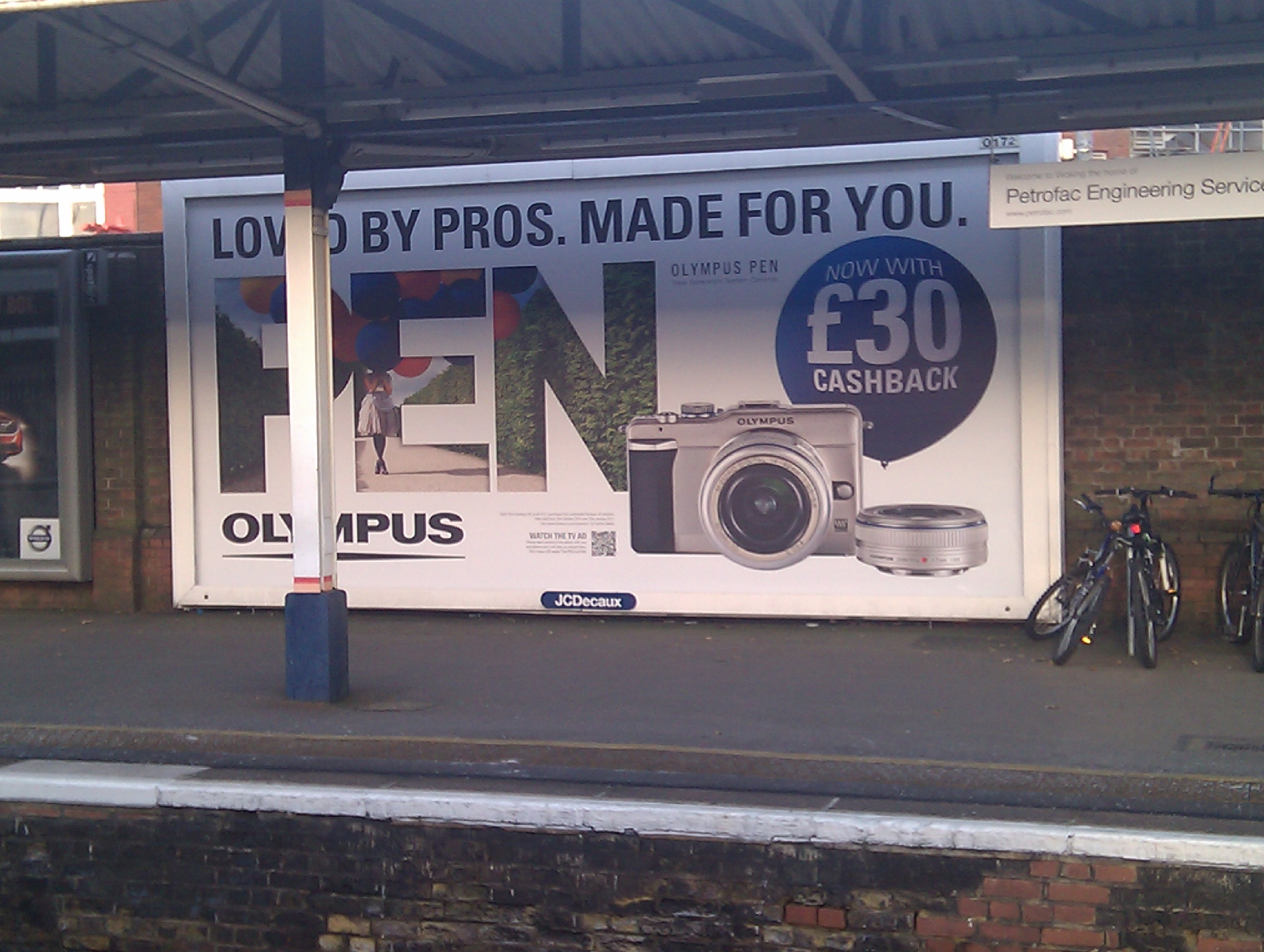 A large poster with an advert for a camera