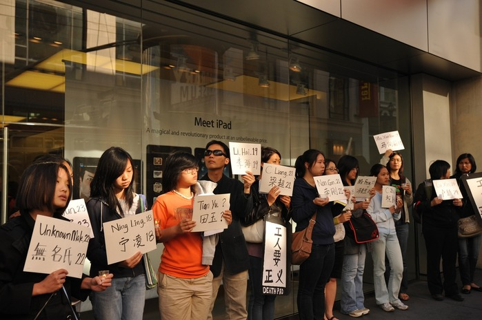 Organizers picket an Apple store in San Francisco - carrying placards showing the names and ages of the Foxconn suicide victims Photo credit: Chinese Progressive Association San Francisco.