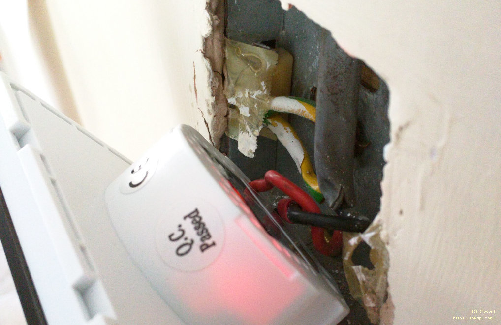 A light switch being installed into a wall