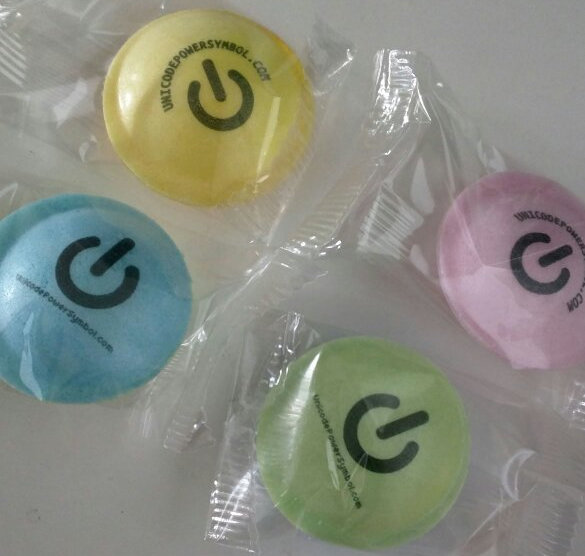fizzy flying saucers with a logo printed on them