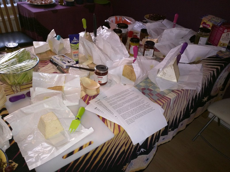 A table laden with cheese and nibbles