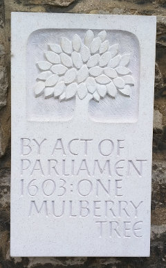 A stone plaque which reads By Act of Parliament 1603 One Mulberry Tree