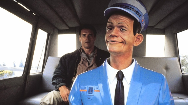The robotic taxi driver from the film Total Recall
