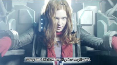 "Amy Pond, from the TV show Doctor Who, is strapped into a chair. She is saying ""OK, kid, This is where where it gets complicated"""