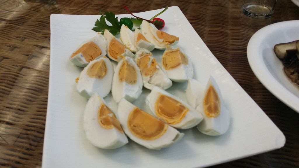 Salted duck eggs, in their shells and quartered