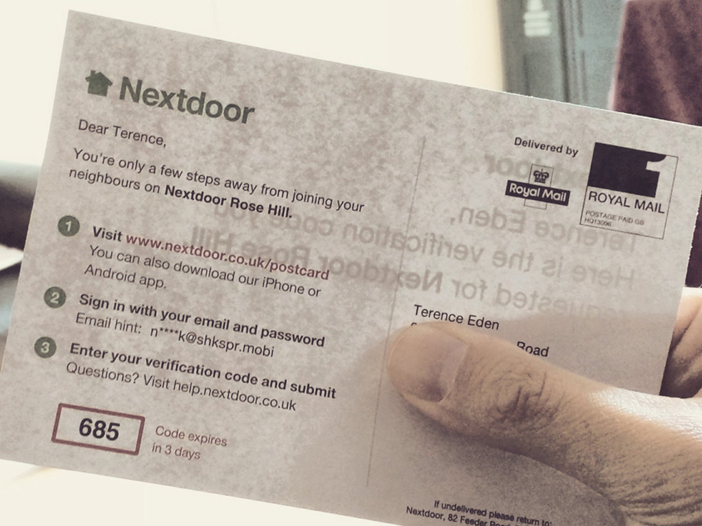 A postcard from Nextdoor - there is a 2FA code printed on it