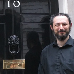 Terence Eden standing outside Number 10 Downing Street.