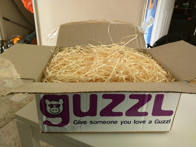 Guzzl box full of straw