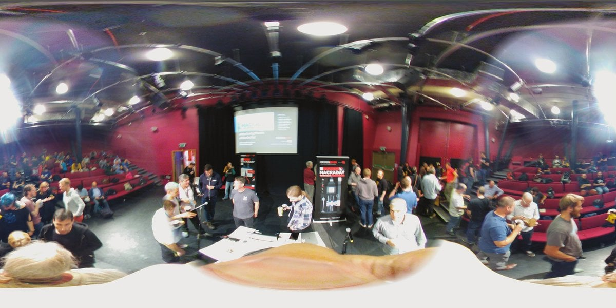 A photosphere showing the inside of a performance theatre. People are chatting with each other