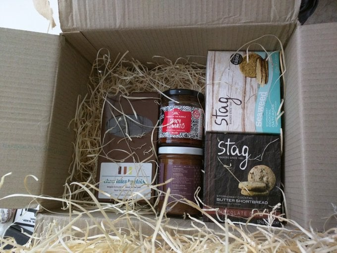 treats inside a box - some jars, boxes, and slabs of chocolate