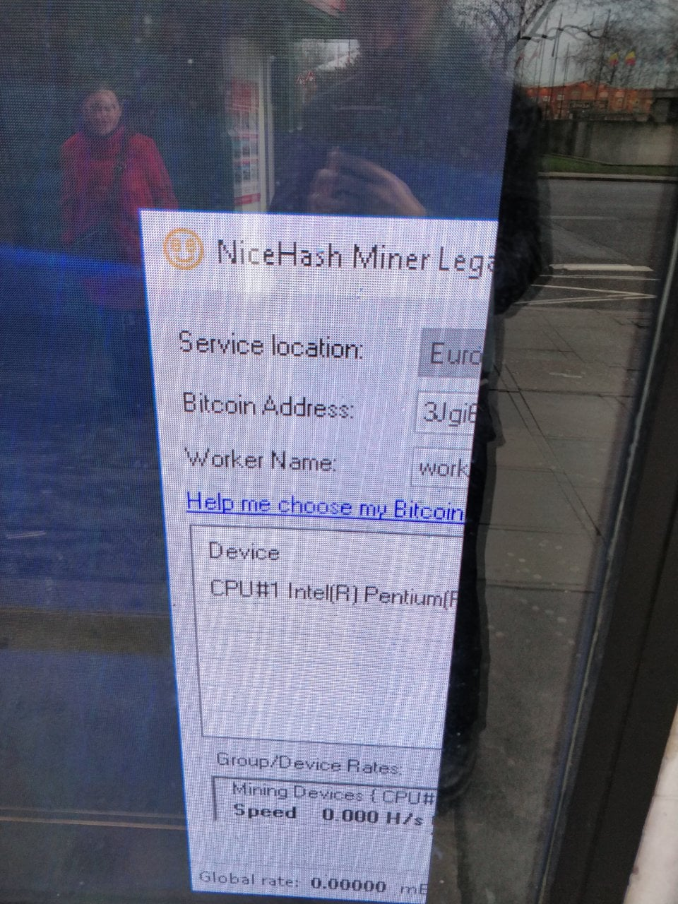 Close up of the window. It is a BitCoin miner