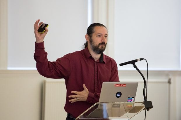 Terence Eden speaking at a conference.