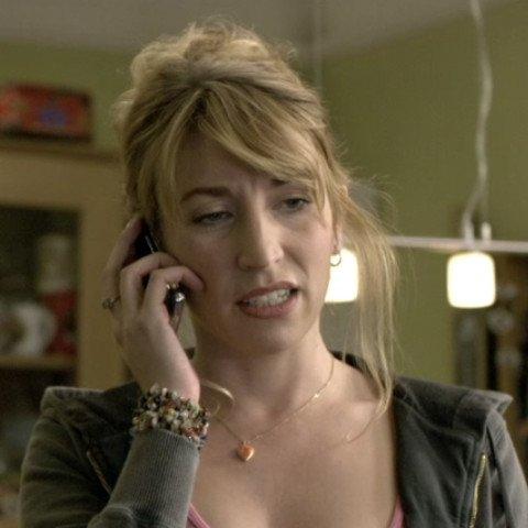 Daisy Haggard holding a phone