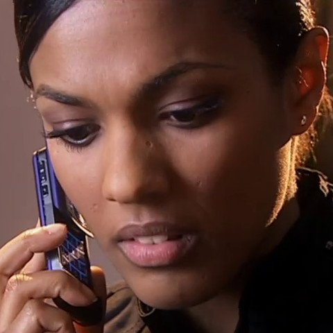 Martha Jones with a slider phone.