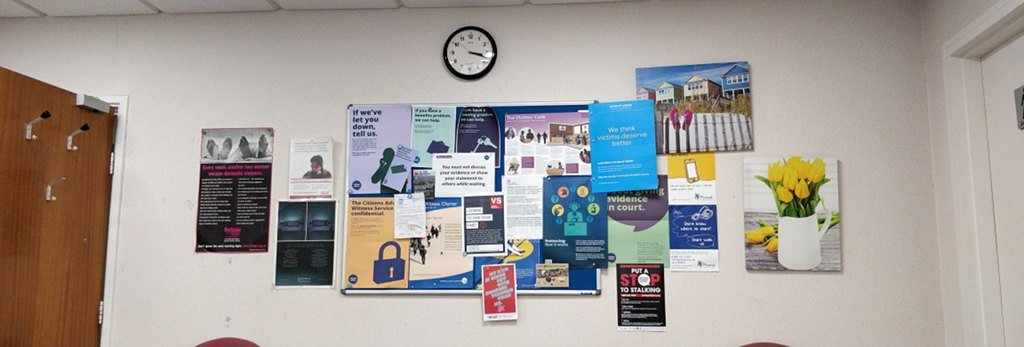 Posters on the wall, telling victims of crime about their rights.