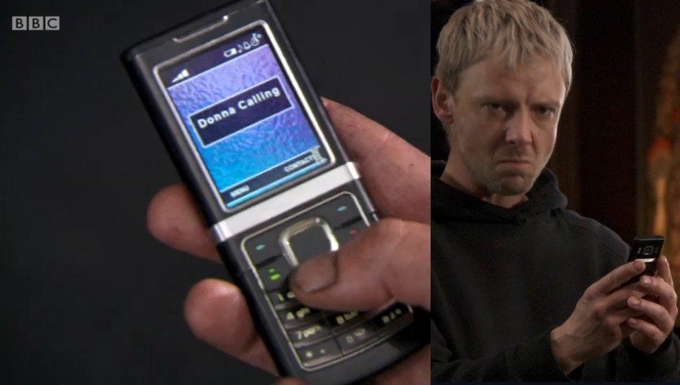 The Master holding a Nokia candybar phone.