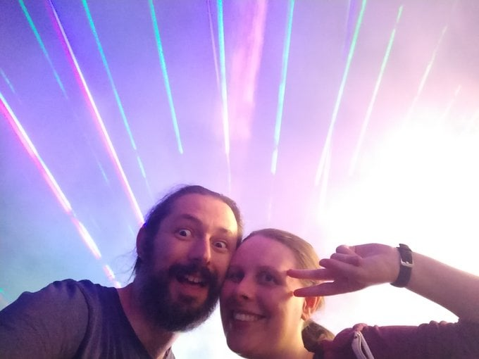 Terence and Liz in front of Lasers at emfcamp.