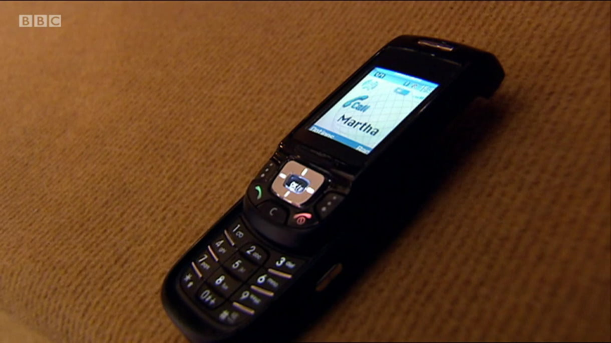 A mobile phone. The display indicates that Martha is calling.
