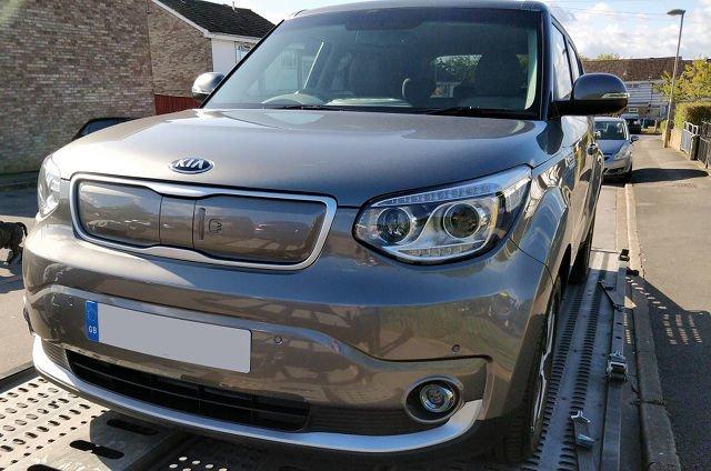 A grey coloured car.