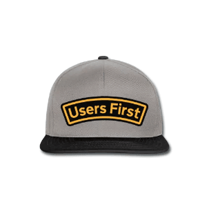 "A baseball cap with the ""Users First"" slogan."