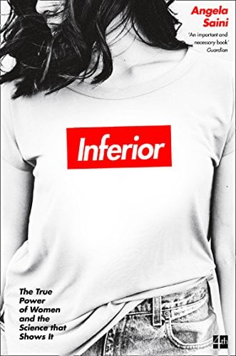 "A young woman wears a t-shirt with ""Inferior"" emblazoned on it."