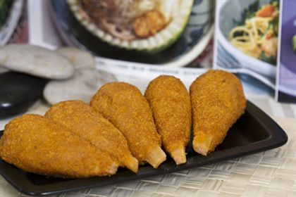 Breaded drumsticks - with a bone sticking out of them.