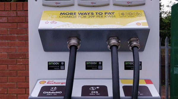Sign on a charger saying electricity costs 39p per kWh.