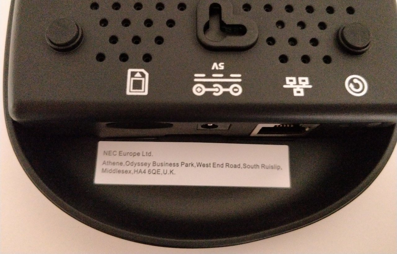 Some anonymous ports on the back of a black plastic device.