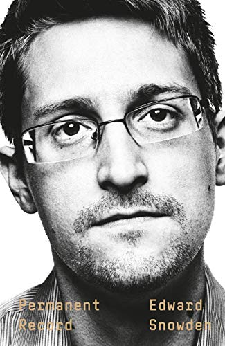 Edward Snowden, a geek in glasses, looks away from the camera.