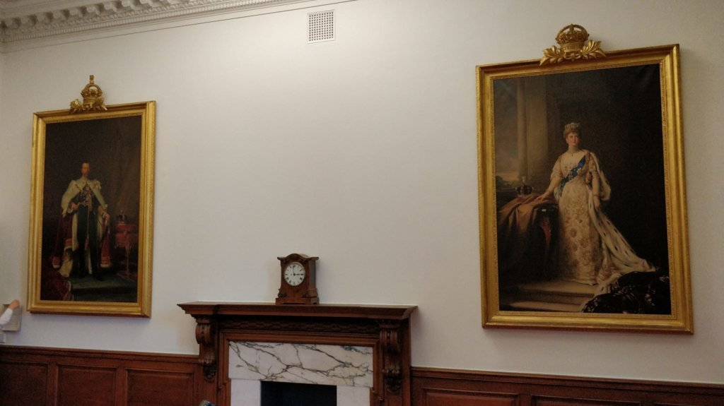 Meeting room with two huge portraits.
