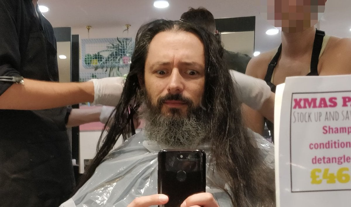 A long haired man with two hairdressers. It's me. And I look bemused.
