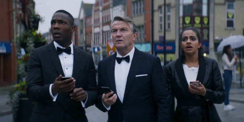 Yaz, Graham, Ryan with phones.