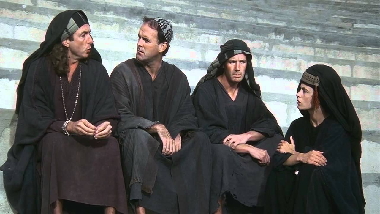 Scene from Monty Python's Life of Brian. The People's Front of Judea sit on the steps, arguing.