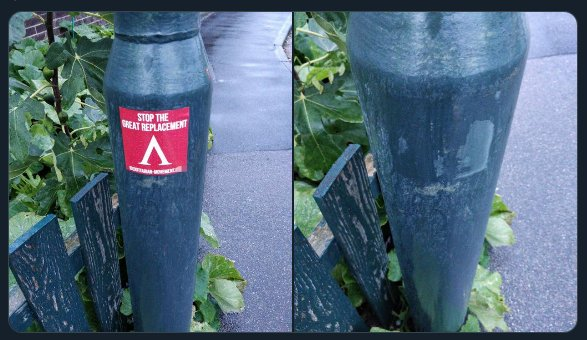 """A """"Stop the great replacement"""" sticker on a lamppost."""