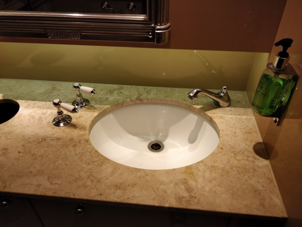 A bathroom sink. The taps are on the opposite site of the sink to the faucet