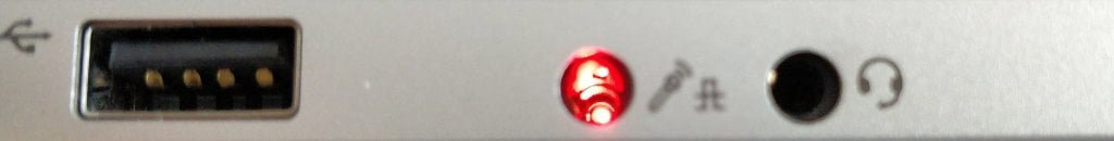 Glowing red light coming out of a microphone port.