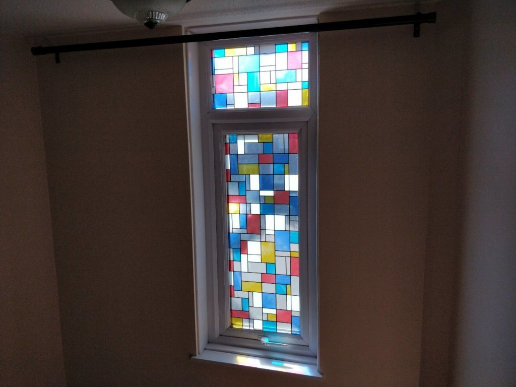 Coloured squares separated by thick black lines. They glow with sunlight.
