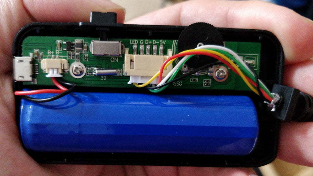 An large battery and a small circuit board.