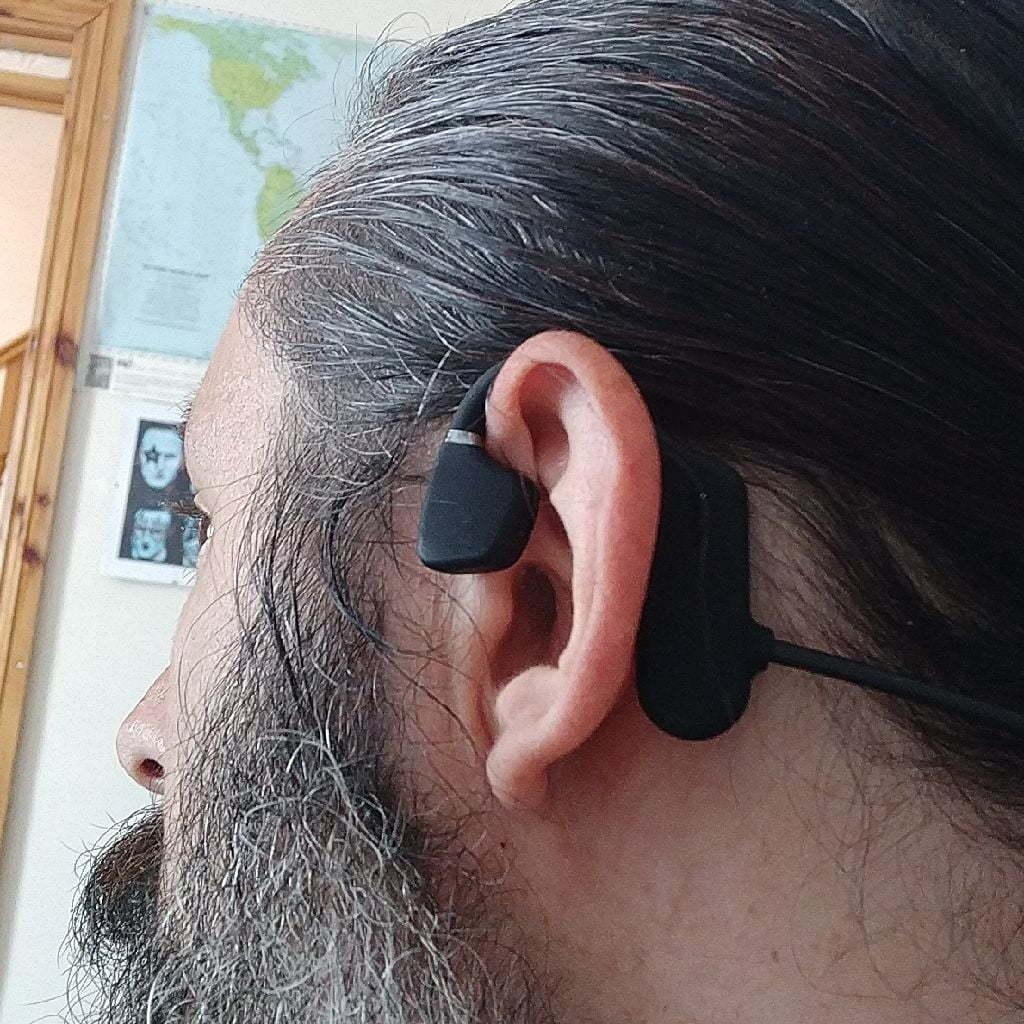 Flat headphones sat outside my ears.