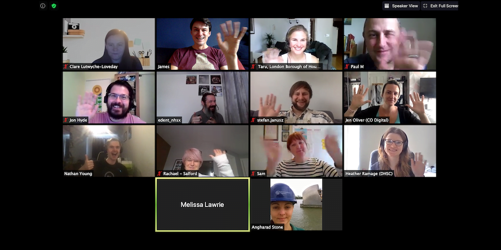 A group of people in a video call waving at their cameras. Each has a name under their video.