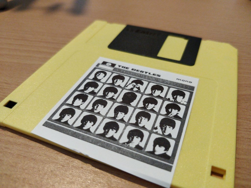 A floppy disk with a low fidelity label of A Hard Day's Night.