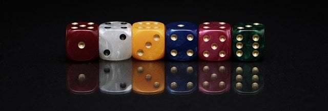 Many coloured dice in a row.