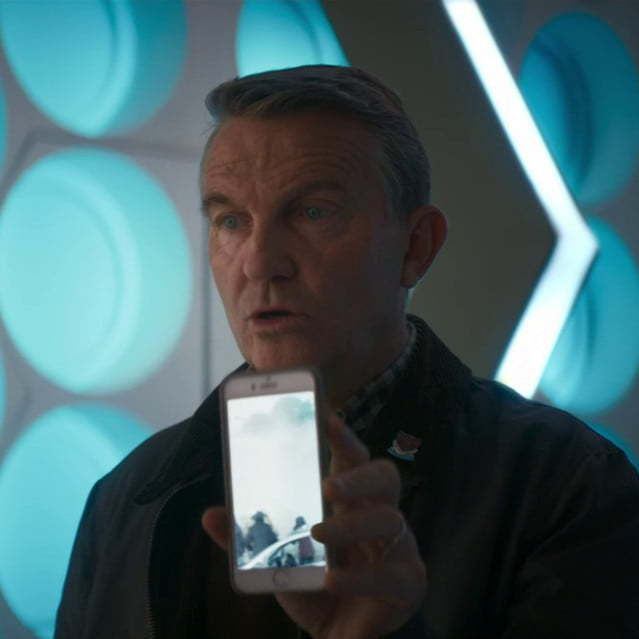 Graham holding an iPhone.