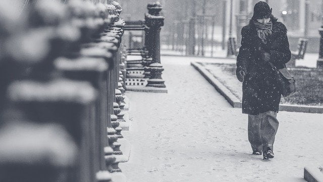 Person walking through the snow.