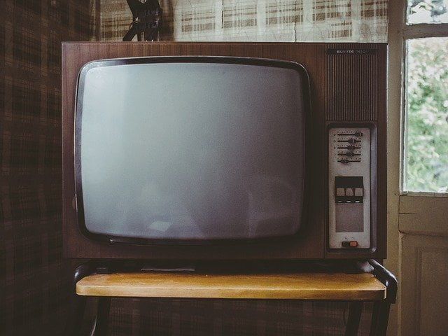 An old fashioned CRT TV. It is blank.