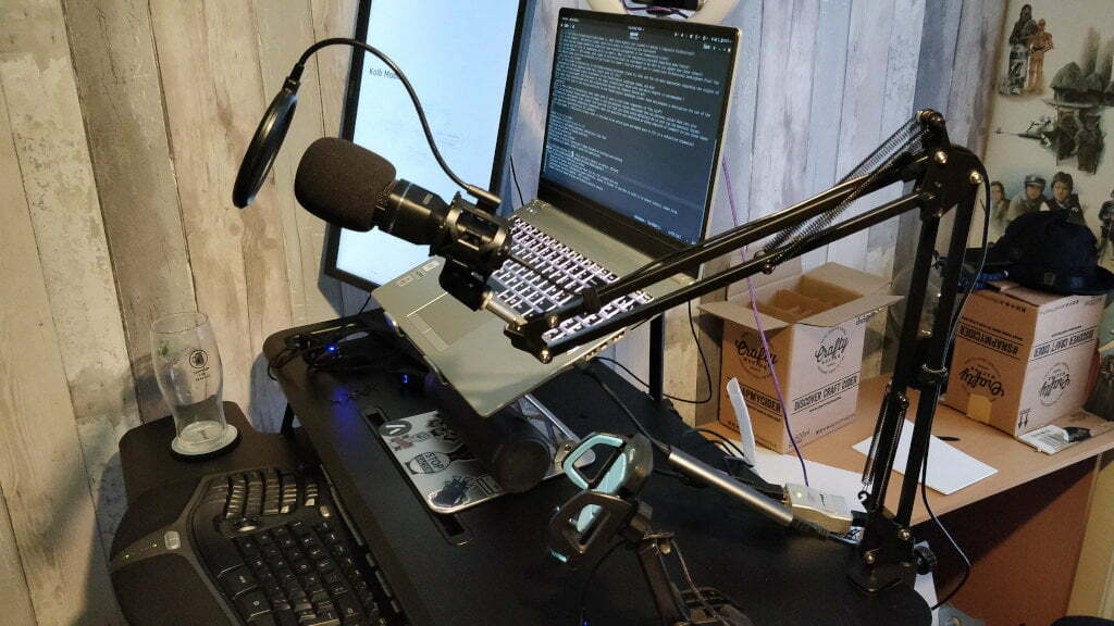 A microphone arm connected to my desk.